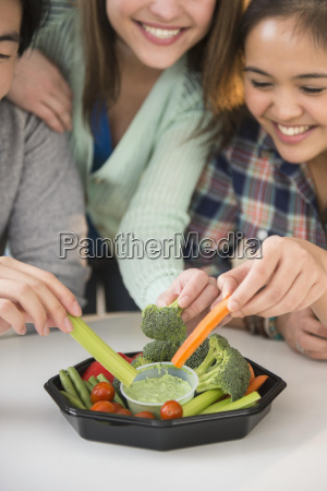 young women and man eating fresh