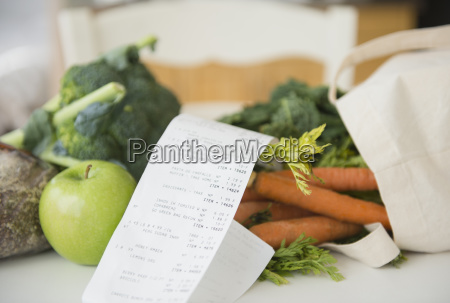 fresh vegetables with store bill