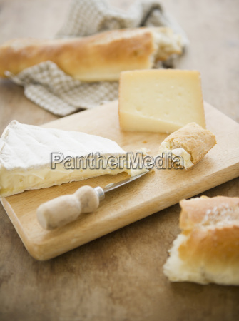 close up of cheese and baguette
