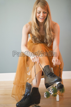 woman wearing dress and tying roller