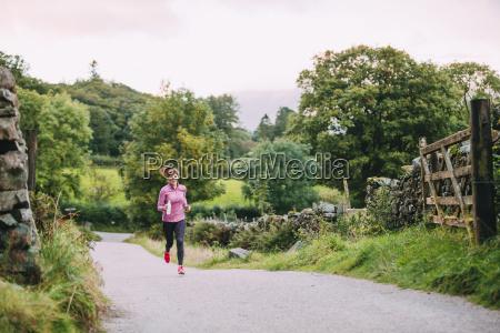 senior running in the lake district