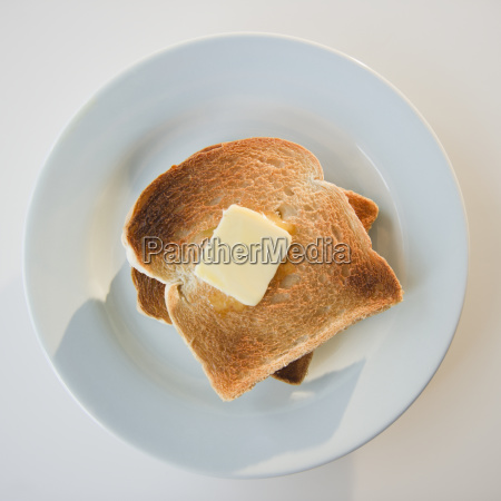close up of toasts with butter