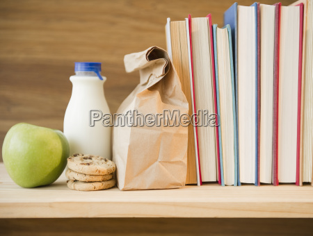 row of books and lunch bag
