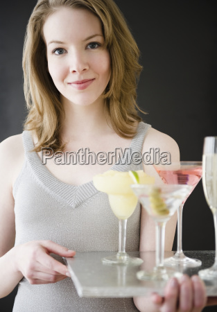 woman, holding, tray, of, cocktails - 23993486