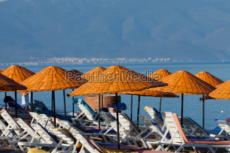 beach loungers and umbrellas on the