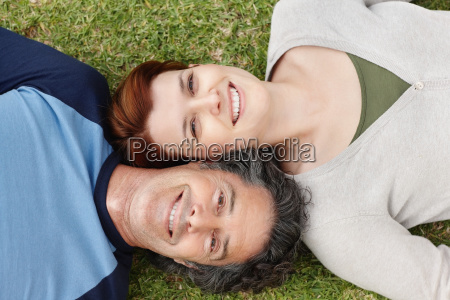 happy couple relaxing on the grass