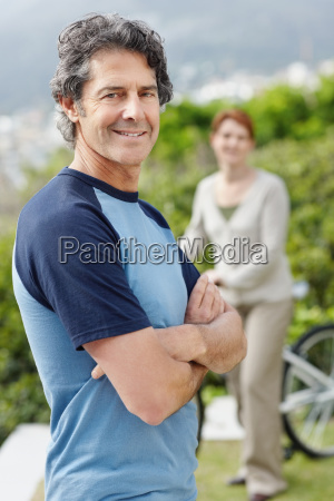 handsome man standing with his arms
