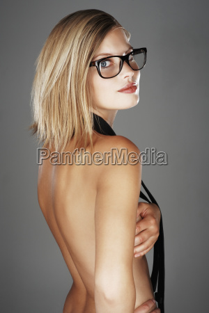 blond woman wearing only a necktie