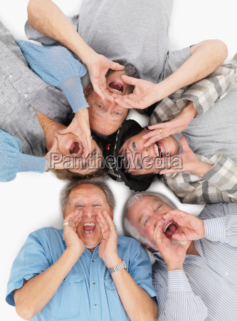 five people lying on the floor