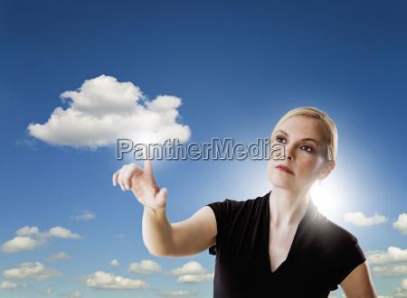 portrait of woman touching cloud