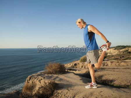 usa california san diego man stretching