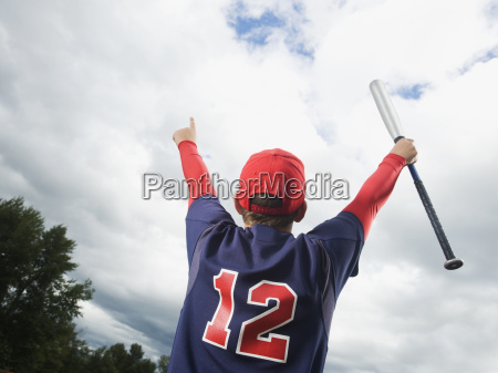 baseball player celebrating with arms raised