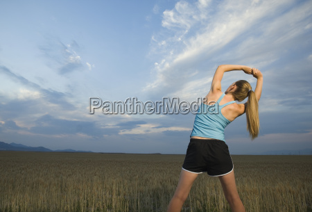 woman in athletic gear stretching