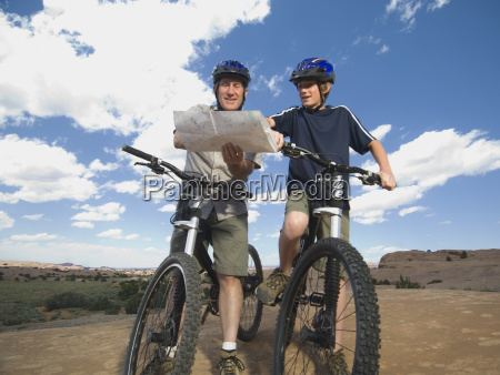 father and son on mountain bikes