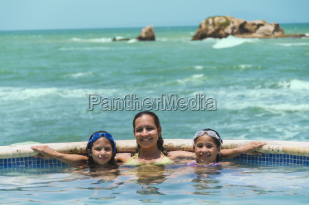 portrait of family in swimming pool