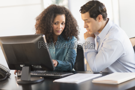 man and woman working at desk