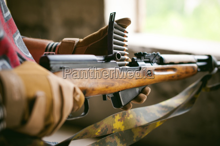 rifle carbine is weapon in hands