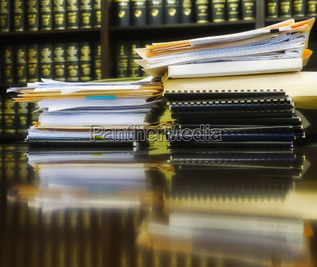 stack of books and files on