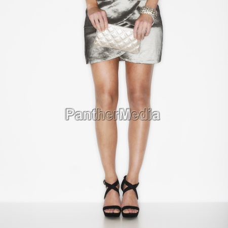 studio shot of woman wearing mini