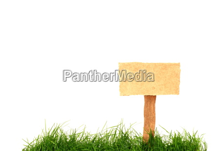 insulated wooden sign in the grass