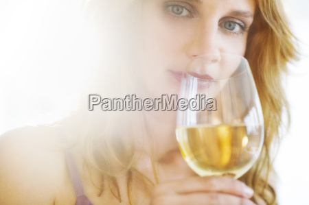 portrait of young woman tasting wine