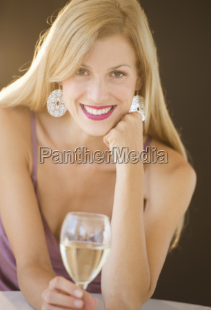 portrait of mid adult woman drinking