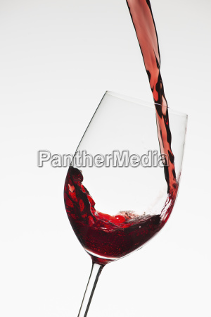 close up of red wine being