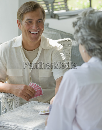 mother and adult son playing card