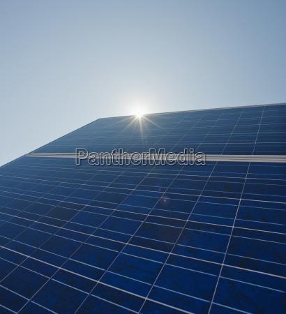 sun shining on solar panel