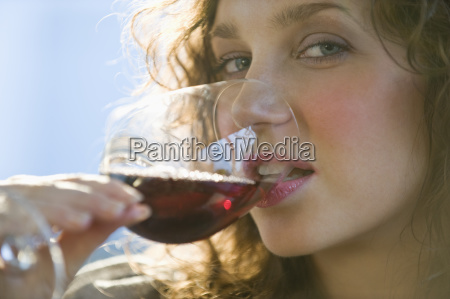 close up portrait of woman drinking