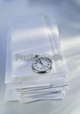 pocket watch on stack of mail