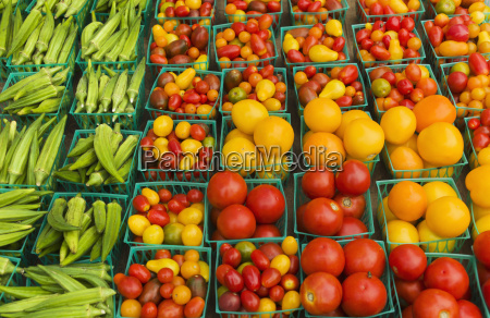 boxes with vegetables on street market
