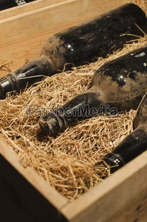 old wine bottles in wooden box