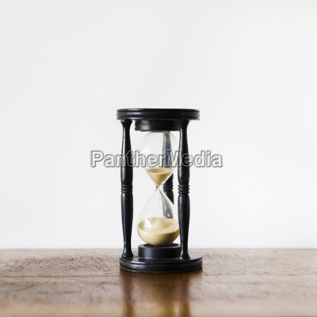 hourglass with pouring sand