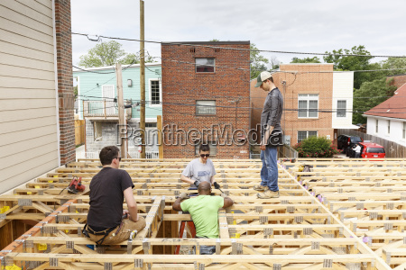 volunteers on the roof at construction