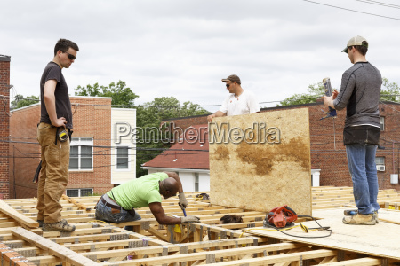 volunteers working on the roof at
