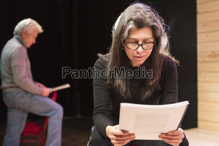 hispanic man and woman reading scripts