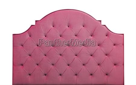 pink velvet bed headboard isolated on
