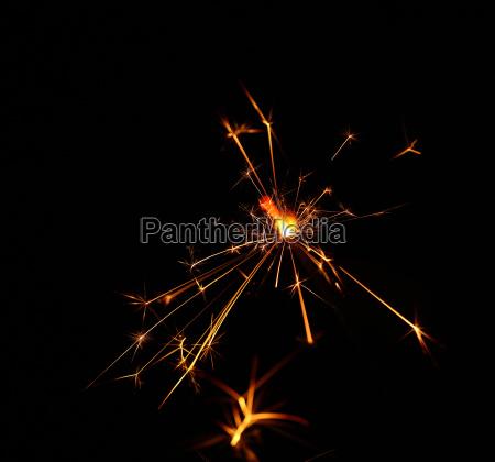 close up one firework sparkler over