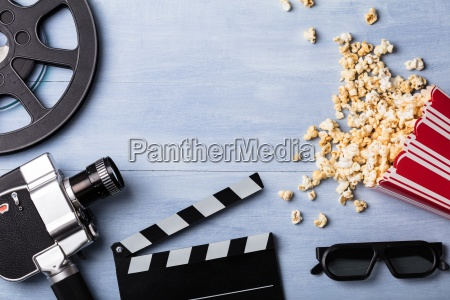 spilled popcorn with clapperboard and movie