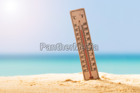 close up of thermometer on sand