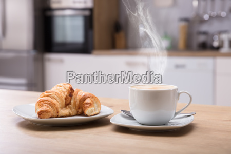 croissant and cup of coffee at