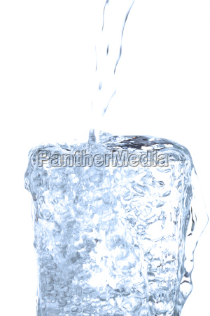 pouring drinking water overflowing into glass