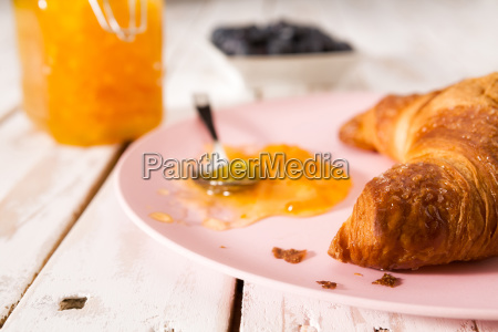 closeup of croissant and jam on