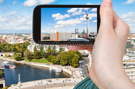 tourist photographs berlin with tv tower