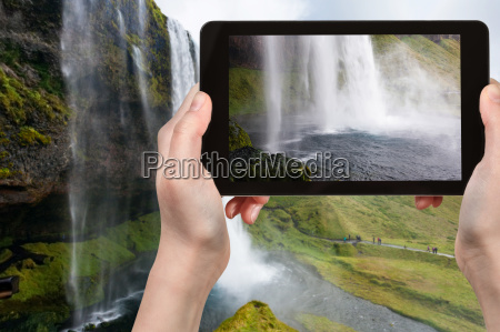 tourist photographs seljalandsfoss waterfall