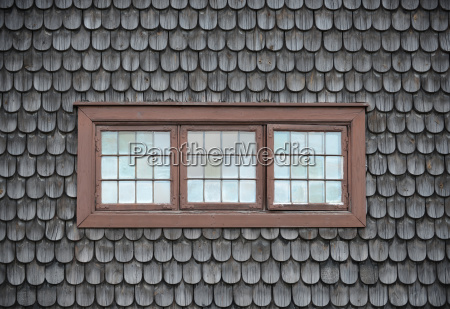 closed old windows on wooden tile