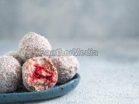 raw lamington bliss balls with raspberries