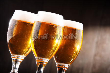 composition with three glasses of lager