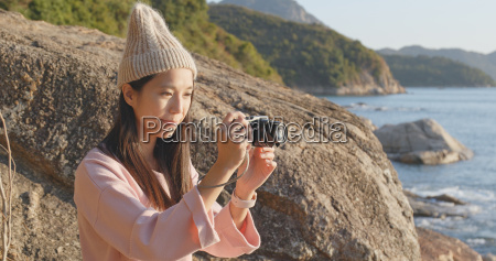 woman taking photo by camera in